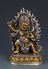 A COLORED SILVER PLATED TIBETAN BUDDHA