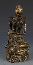 A FINELY CARVED BRONZE ROHAN MODEL