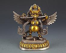 A SILVER PLATED BIRD LIKE TIBETAN BUDDHA