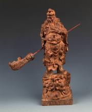 A FINELY CARVED AGARWOOD GUAN GONG FIGURE