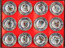 A GROUP OF TWELVE FINELY PAINTED PORCELAIN PLATE