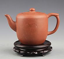 A YIXING ZISHA TEAPOT WITH COVER