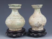 A PAIR OF OLD GREEN COLORED PORCELAIN BOTTLE