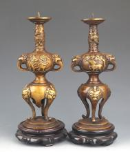 A PAIR OF FINELY CARVED BRONZE CANDLESTICK