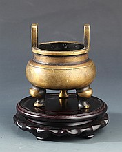 A SMALL TRIPOD BRONZE CENSER