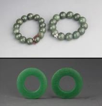 GROUP OF TWO JADE BRACELETS AND ROUND JADE