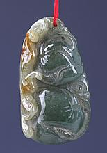 A FINELY CARVED JADEITE PENDANT