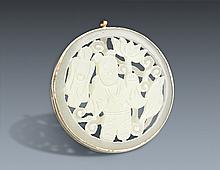 A FINELY CARVED JADE PENDANT WITH SILVER