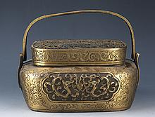 A DOUBLE DRAGON FINELY CARVED BRONZE HAND WARMER