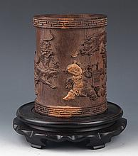 A FINELY CARVED AGARWOOD BRUSH POT