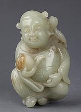 A FINELY CARVED GREENISH WHITE JADE PENDANT