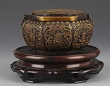 A DETAILED AND FINELY CARVED BRONZE HAND WARMER