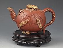 A FINELY CARVED ROUND YIXING ZISHA TEAPOT