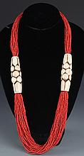 A WELL MADE CORAL NECKLACE