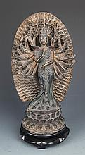 A FINELY CARVED RONZE THOUSAND HAND GUAN YIN