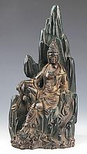 A RARE AND FINELY CARVED BRONZE GUAN YIN