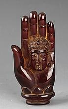 A COPY OF AMBER IN FIGURE OF BUDDHA HAND
