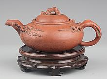A FINELY CARVED YIXING YIXING ZISHA PLUM TEAPOT