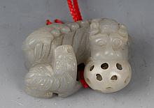 A FINELY CARVED HETIAN WHITE JADE IN FITURE OF RUI SHOU