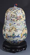 A STORY PAINTED DOUCAI PORCELAIN JAR WITH COVER