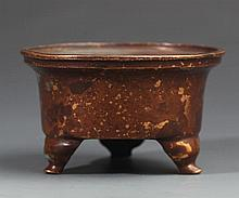 A SMALL BRONZE THREE FOOT CENSER