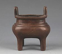 A DOUBLE EAR HIGH STAND BRONZE CENSER