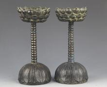 A PAIR OF LOTUS SHAPED TALL CANDLESTICKS