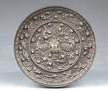 A RARE AND FINELY CARVED BRONZE MIRROR
