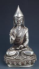 A RARE AND FINELY CARVED SIVER PLATED BUDDHA