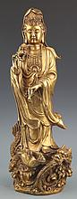 A DETAIL AND FINELY CARVED GILT-BRONZE GUAN YIN MODEL