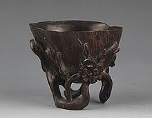 A FINELY CARVED ROSEWOOD CUP