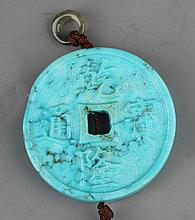 A TURQUOISE COIN SHAPE PENDANT