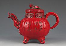 A FINELY CARVED RED COLOR CHINESE LACQUER TEAPOT