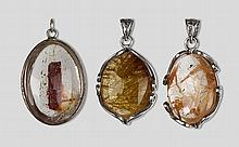 A GROUP OF THREE NATURAL RUTILATED QUARTZ