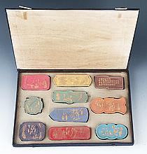 A FINELY CARVED SET OF TEN COLORED CHINESE INK WITH BOX