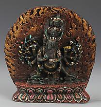 A TIBETAN BUDDHA CARVED TURQUOISE DECORATION
