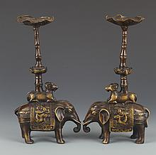 A PAIR OF FINELY CARVED ELEPHANT CANDLESTICKS