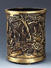 A DETAILED AND FINELY CARVED BRONZE BRUSH POT