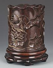 A REDWOOD BRUSH POT EMBOSSED WITH LOTUS FLOWER