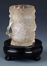 A FINELY CARVED BAMBOO SHAPED CRYSTAL BRUSH POT