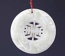 A RARE AND FINELY CARVED ROUND HETIAN WHITE JADE
