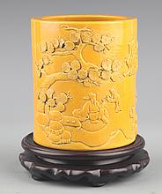 A YELLOW COLORED FINELY CARVED PORCELAIN BRUSH POT