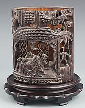 A FINELY CARVED BAMBOO BRUSH POT