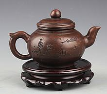 A FINELY CARVED YIXING ZISHA TEA POT AND COVER