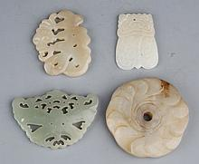 A GROUP OF FOUR FINELY CARVED PALE CELADON JADE