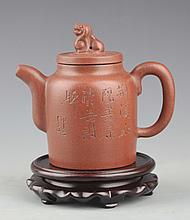 A CARVED YIXING ZISHA TEA POT AND COVER