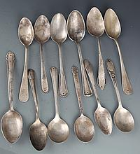 A GROUP OF TWELVE SILVER PLATED SPOON