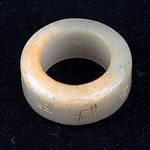 A FINELY CARVED WHITE JADE RING