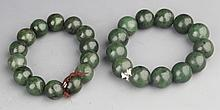 A GROUP OF TWO SPINACH JADE BRACELETS