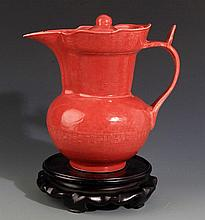 A RED COLOR  GLAZED PORCELAIN WATER POT WITH COVER
